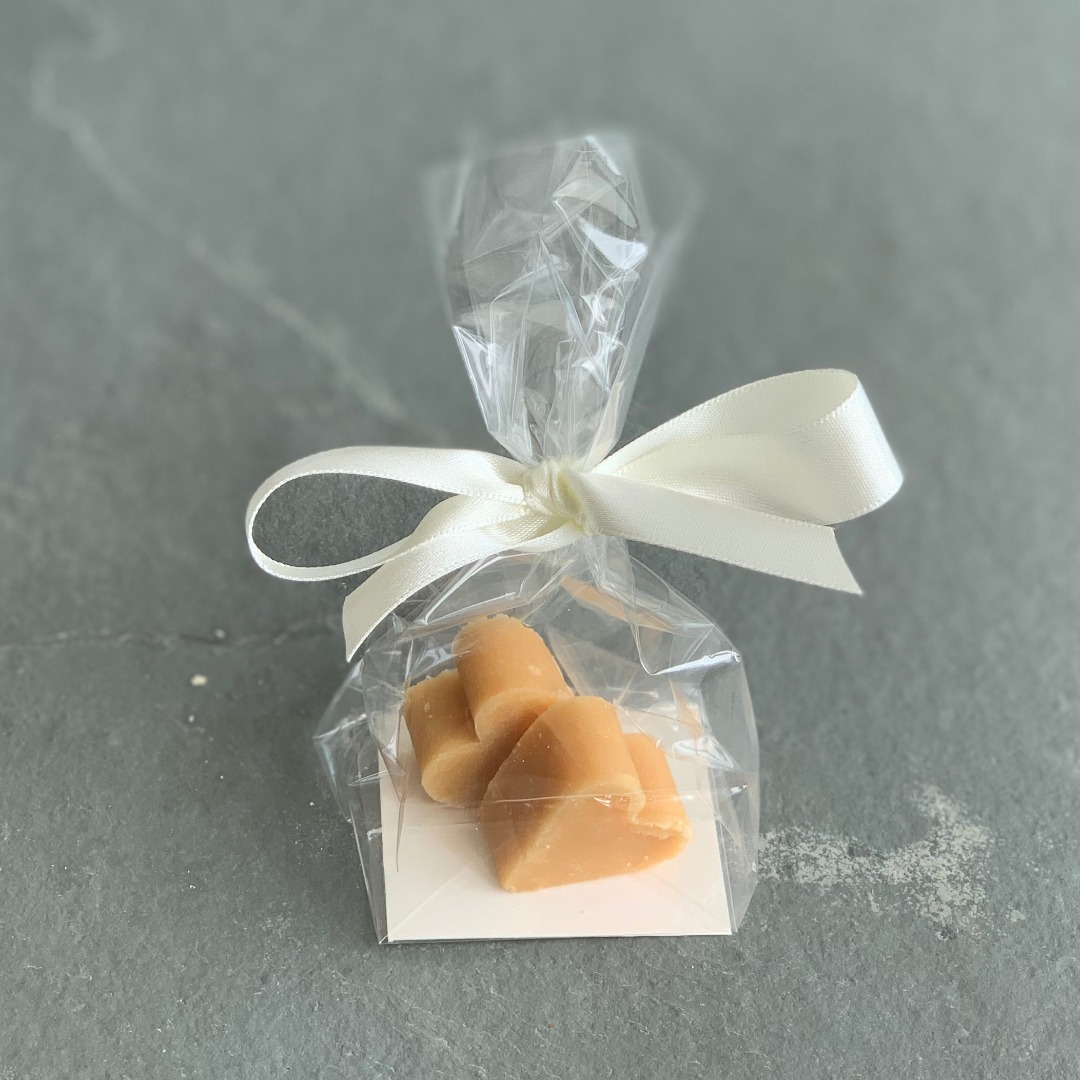 Clear bag of 2 small tablet heart wedding favours